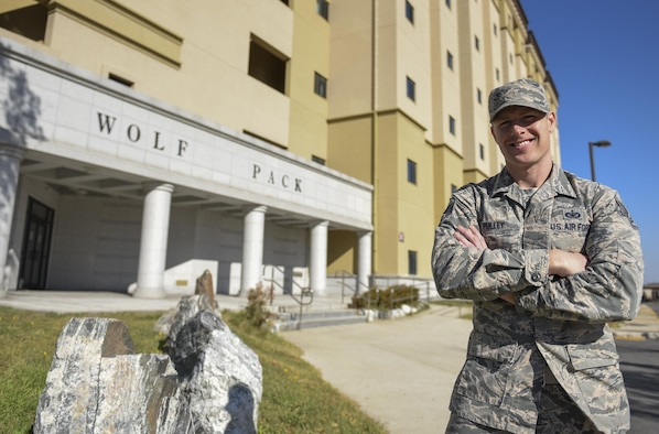 Staff Sgt. James Pulley, 8th Civil Engineering Squadron airmen dormitory leaders, stands outside the dorm he manages at Kunsan Air Base, Republic of Korea, Nov. 15, 2016. ADLs are responsible for the management of dorm logistics and the wellbeing of occupants who reside in them. (U.S. Air Force photo by Senior Airman Michael Hunsaker/Released)