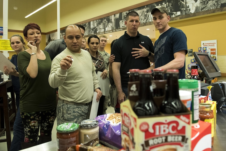 Members of Spangdahlem estimate the total price of various food items during the Spangdahlem Spouses and Enlisted Members Club Commissary Sweep at Spangdahlem Air Base, Germany, Nov. 15, 2016. Along with price estimation, participants answered riddles to compete for free groceries and commissary gift cards. (U.S. Air Force photo by Airman 1st Class Preston Cherry)