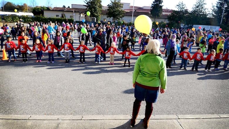 Aviano Elementary School students and faculty prepare for a choreographed dance during a World Kindness Day celebration at Aviano Air Base, Italy on Nov. 15, 2016. More than 600 students and faculty, performed the dance to promote kindness. (U.S. Air Force photo by Senior Airman Areca T. Bell)