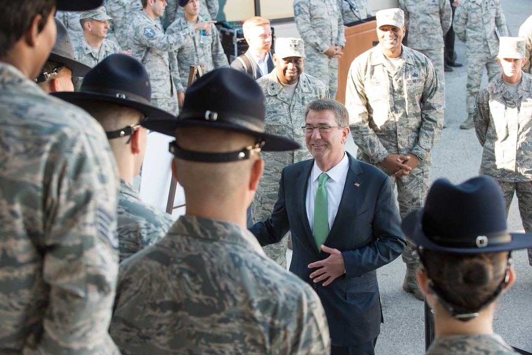 Defense Secretary Ash Carter speaks with Air Force training instructors during a visit to Joint Base San Antonio-Lackland, Texas.