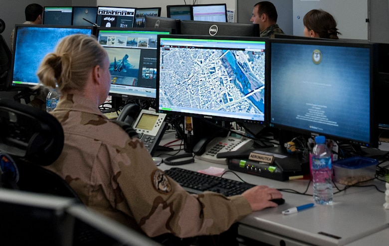 A U.S. Coalition Intelligence Fusion Cell member reviews a map at the Combined Air and Space Operations Center Nov. 16, 2016, at Al Udeid Air Base, Qatar. The CIFC is a diverse multinational team that plans, coordinates, develops and disseminates timely, relevant and accurate information among international partners and divisions within the CAOC. (U.S. Air Force photo by Staff Sgt. R. Alex Durbin)