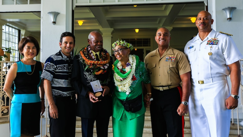 Distinguished guests stand with Dr. Ernest James Harris, Jr. during his Congressional Gold Medal ceremony in Honolulu Nov. 12, 2016. Harris was awarded his Congressional Gold Medal for his service as a Montford Point Marine.