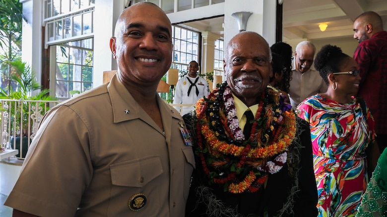 U.S. Marine Brig. Gen. Brian W. Cavanaugh, deputy commander of U.S. Marine Corps Forces, Pacific, and Dr. Ernest James Harris, Jr. stand together after a Congressional Gold Medal presentation in Honolulu Nov. 12, 2016. Harris was awarded his Congressional Gold Medal for his service as a Montford Point Marine.