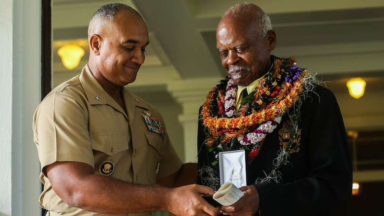 U.S. Marine Corps Brig. Gen. Brian W. Cavanaugh, deputy commander of U.S. Marine Corps Forces, Pacific, presents the Congressional Gold Medal to Dr. Ernest James Harris, Jr. in Honolulu Nov. 12, 2016. Harris was awarded his Congressional Gold Medal for his service as a Montford Point Marine.