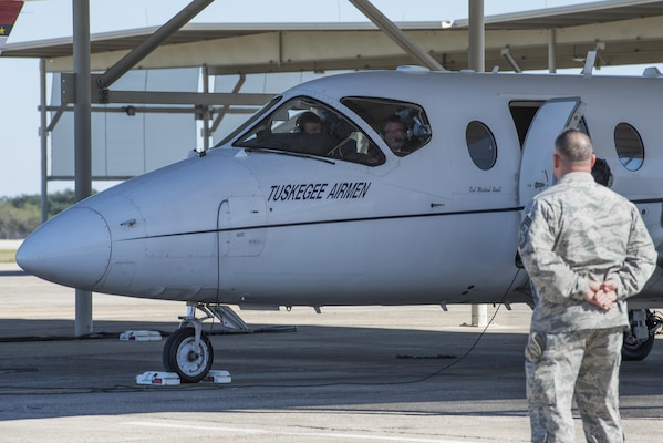 Secretary of Defense Ash Carter prepares to take an orientation flight in a T-1A Jayhawk as Chief Master Sgt. Brian Kentta, 12th Flying Training Wing command chief, looks on at Joint Base San Antonio-Randolph Nov. 16, 2016. Carter made visits to all three JBSA locations to ensure future readiness of service members. (U.S. Air Force photo by Airman 1st Class Lauren Ely)