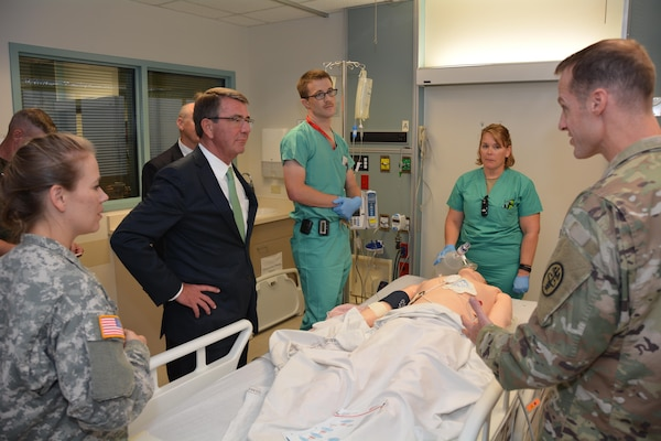 Secretary of Defense Ash Carter and U.S. Army Lt. Col. Matthew Borgman discuss wireless transmission of CPR using a mannequin simulator during his November 16 visit to Brooke Army Medical Center, Fort Sam Houston, Texas. BAMC is the Army's largest and busiest medical center. Secretary Carter personally thanked wounded and ill warriors, their families and BAMC staff for their service and sacrifice. Secretary Carter toured labs and simulation centers pioneering new advances in diagnostic imaging and new medical training aids. His visit at BAMC was part of a tour of Joint Base San Antonio, with stops at JBSA-Lackland and JBSA-Randolph. (U.S. Army photo by Robert Shields/Released)