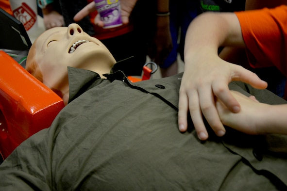 A child learns to performs chest compressions on a SimMan during the 13th Annual Region 15 Robotics Competition at Angelo State University in San Angelo, Texas, Nov. 7, 2016.  The SimMan is is capable of simulating a pulse, breathing and CPR. (U.S. Air Force photo by Airman 1st Class Randall Moose/Released)