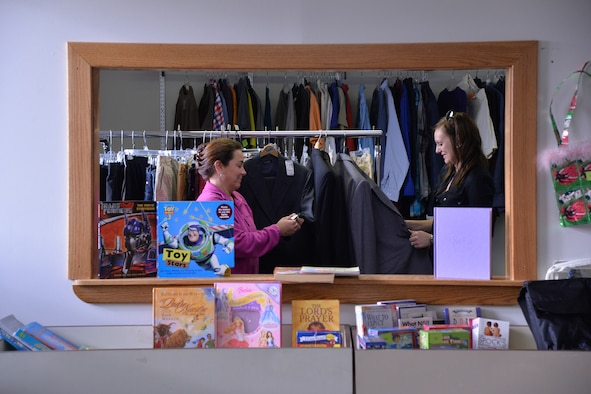 Angie Folds, senior spouse mentor and volunteer, left, and Chantel Orcutt, thrift store co-chairman, examine clothing at the Malmstrom Thrift Store Nov. 15, 2016, at Malmstrom Air Force Base, Mont. The thrift store is a volunteer-only, non-profit operation held on base with all of the proceeds going back to active-duty dependents and veterans to further secondary education. (U.S. Air Force photo/Airman 1st Class Daniel Brosam)