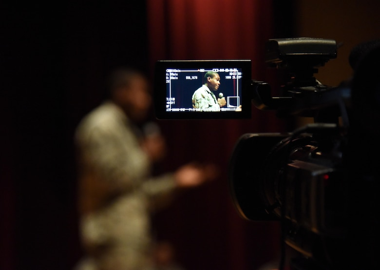 Airman 1st Class Rayan Paul, 81st Diagnostic and Therapeutics Squadron pharmacy technician, shares his story about overcoming an accident and being resilient during a Storytellers event at the Welch Theater Nov. 16, 2016, on Keesler Air Force Base, Miss. The event, consisting of three speakers, was one of several events held throughout Dragon Week, which focuses resiliency and teambuilding initiatives across the base. (U.S. Air Force photo by Kemberly Groue/Released)