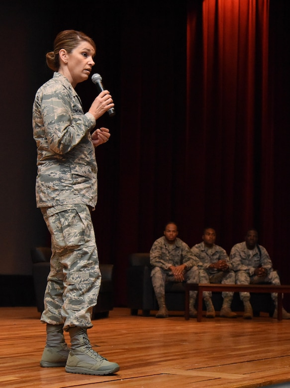 Col. Michele Edmondson, 81st Training Wing commander, delivers remarks during a storytellers event at the Welch Theater Nov. 16, 2016, on Keesler Air Force Base, Miss. The event, consisting of three speakers who shared their stories about resiliency, was one of several events held throughout Dragon Week, which focuses on resiliency and teambuilding initiatives across the base. (U.S. Air Force photo by Kemberly Groue/Released)
