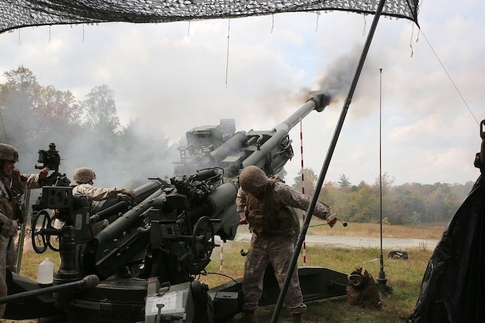 Marines from Training and Education Command fire the M777 Lightweight 155mm Howitzer during a demonstration Oct. 20, aboard Marine Corps Base Quantico, Va. During the demonstration, employees from Marine Corps Systems Command's Ammunition Program Management Office gained first-hand experience of field artillery Marines in action to inform their work behind the scenes at MCSC. (U.S. Marine Corps photo by Mathuel Browne)