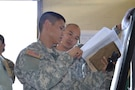 Sgt. Leonardo De Luna, a student attending the 4960th Multi-Functional Training Brigade new pilot Army Medical Department Advanced Leader Course Phase II, explains his part of a training exercise to Staff Sgt. Brandon Maki, another student enrolled in the class. The course was held at Fort Shafter Flats, Hawaii, October 30 - November 12, 2016.