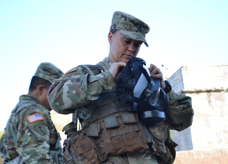 Staff Sgt. Linsey McCray, an active duty Soldier attending the 4960th Multi-Functional Training Brigade (Total Army School System) pilot Army Medical Department Advanced Leader Course Phase II, inspects her mask during a situational training exercise. The course was held at Fort Shafter Flats, Hawaii, October 30 - November 12, 2016.