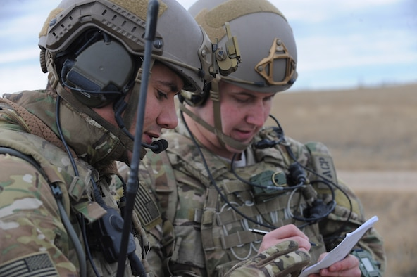Staff Sgts. Edward Breen and Michael Pincher, joint terminal attack controllers assigned to the 5th Air Support Operations Squadron, Joint Base Lewis-McChord, Wash., write down location coordinates during a joint training exercise at the Powder River Training Complex, Belle Fourche, S.D., Nov. 16, 2016. The training exercise was designed to train both JTACs and aircrew under realistic scenarios that support full spectrum operations against modern threats. (U.S. Air Force photo by Senior Airman Anania Tekurio/Released)