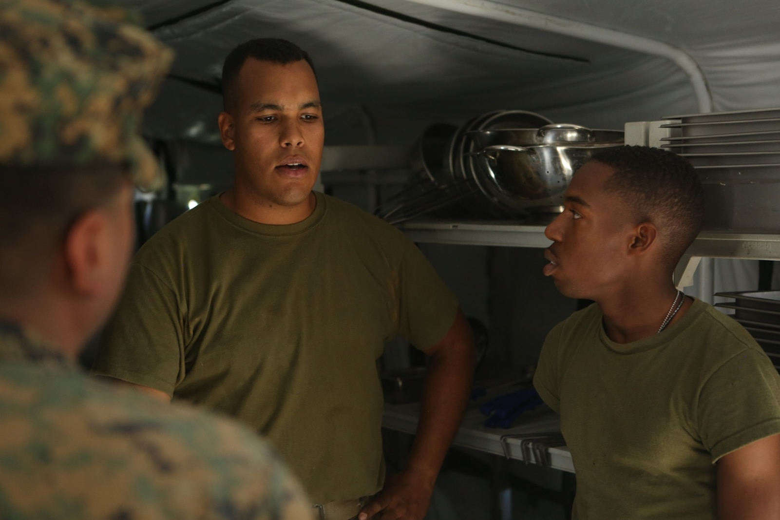 U.S. Marine Lance Cpl. Emmauel Gomezricart and Lance Cpl. Daniel Howell lead medical technicians on a walkthrough of an expeditionary field kitchen during Preventative Medicine Exercise 2016 at Camp Pendleton, Calif., Nov. 10, 2016. The medical technicians inspected for sanitation, operational ability of the equipment and for the presence of vermin. 1st Medical Battalion used this exercise to better prepare their Sailors for deployments and to practice accomplishing an objective in a field environment. Gomezricart and Howell are food service specialists with Food Service Company, Headquarters Regiment, 1st Marine Logistics Group. (U.S. Marine Corps photo by Lance Cpl. Joseph Sorci)