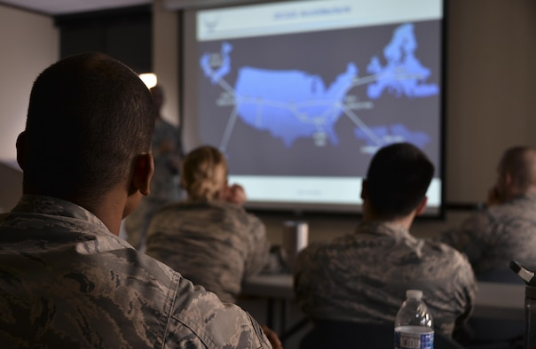 Airmen from the 70th Intelligence, Surveillance and Reconnaissance Wing are shown their area of responsibilities around the world during National Tactical Integration training November 4, 2016 at Fort Meade, Md. AF NTI works as an enterprise that collaborates to enhance Air Component operations around the world, as well as leveraging critical nation Intelligence Community information and capabilities. (U.S. Air Force photo/Staff Sgt. Alexandre Montes)