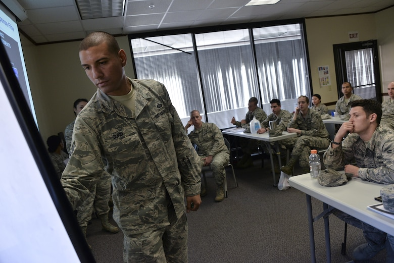 Staff Sgt. David Gunn, 70th Operations Support Squadron, writes down answers given by intelligence Airmen from the 70th Intelligence, Surveillance and Reconnaissance Wing during their National Tactical Integration training November 4, 2016 at Fort Meade, Md. AF NTI works as an enterprise that collaborates to enhance Air Component operations around the world, as well as leveraging critical nation Intelligence Community information and capabilities. (U.S. Air Force photo/Staff Sgt. Alexandre Montes)