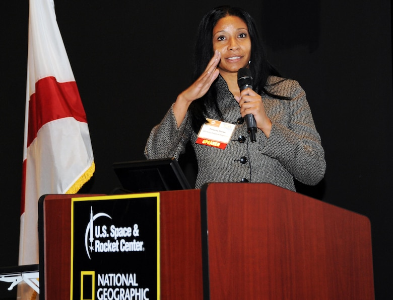 Porscha Porter, Huntsville Center's Energy Division branch chief for Strategy and Business Management, moderates a panel focusing on federal government energy initiatives and partnerships during Energy Huntsville's Energy Summit Nov.15 at the U.S. Space and Rocket Center.