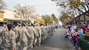 Airmen from Travis Air Force Base, Calif., march down North Texas Avenue in  Fairfield Calif., Nov. 11, 2016, during the  city's Veterans Day Commemoration and Parade celebration. The parade also featured performances from the U.S. Air Force Band of the Golden West and a C-17 Globemaster III flyover. ( (U.S. Air Force Photo by T.C. Perkins Jr.)