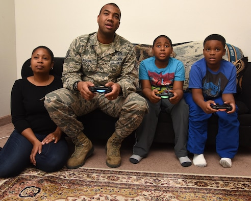 Tech. Sgt. Christopher McShan II, 341st Civil Engineer Squadron emergency management flight section chief, spends quality time with his family at their home at Malmstrom Air Force Base, Mont., Nov. 17, 2016. McShan is involved in his home life, but also work as well. (U.S. Air Force photo/Senior Airman Jaeda Tookes)