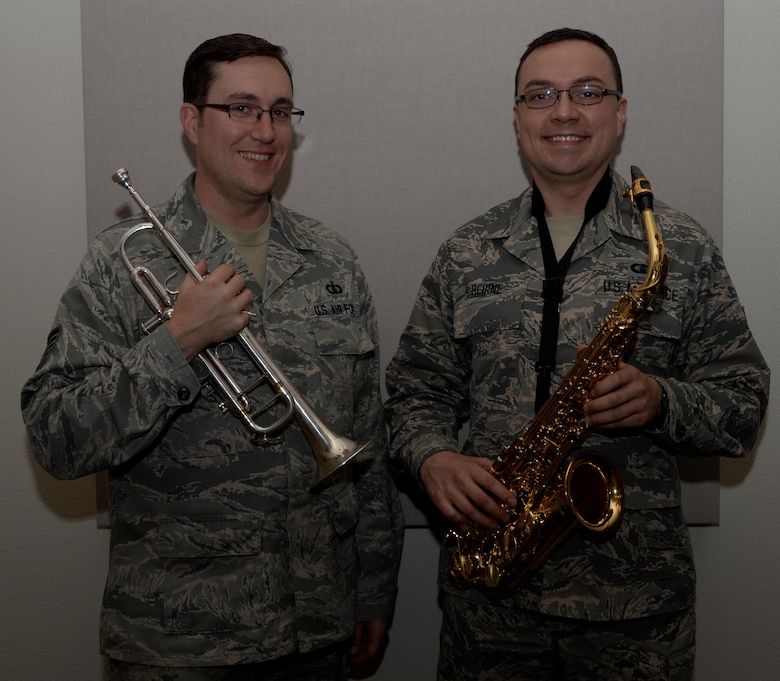 Tech. Sgt. Tom Salyers, (Left) U.S. Air Force Band of the Golden West Travis Brass Quintet noncommissioned officer in charge from Pittsburgh, Pennsylvania and Airman 1st Class, Ian O'Bierne, BOGW saxophonist from Pennsauken, New Jersey, pose for a photo at Travis Air Force Base, Calif., Nov. 15, 2016. Salyers and O'Bierne joined the band in July. (U.S. Air Force photo by Tech. Sgt. James Hodgman)