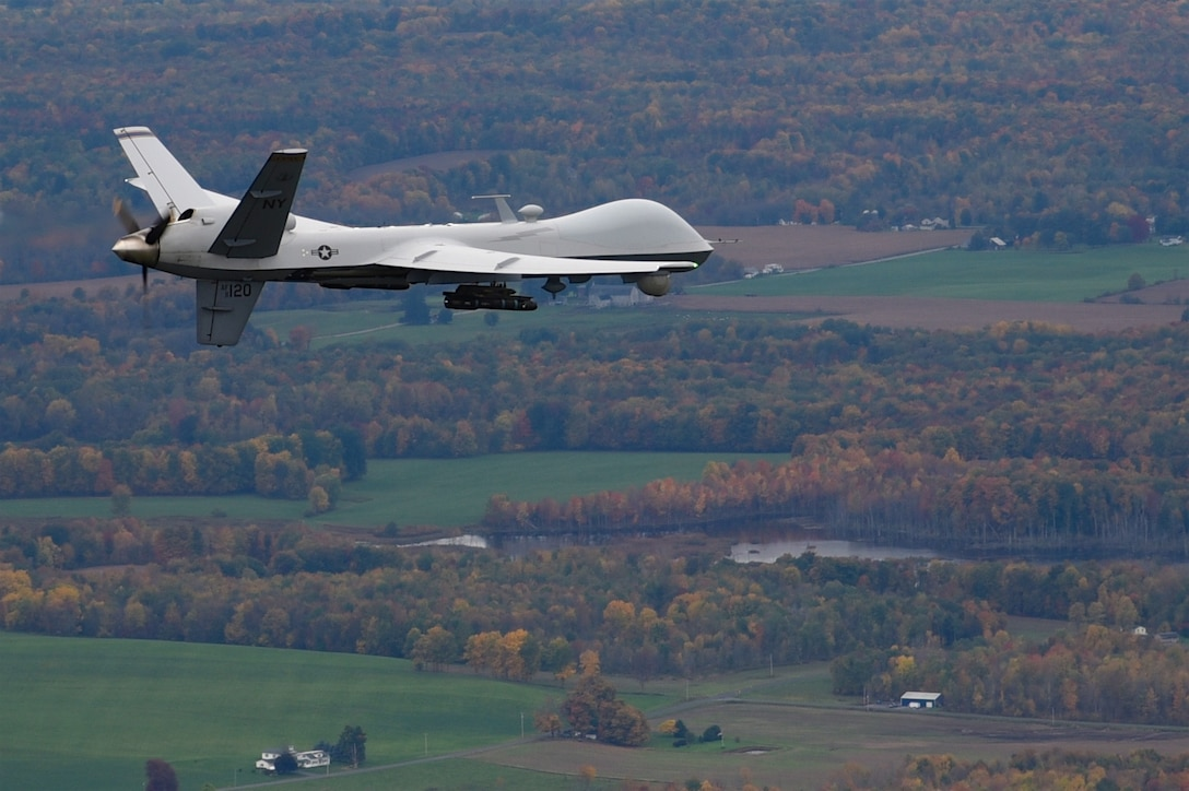 Syracuse, NY – A remotely piloted MQ-9 Reaper operated by the New York Air National Guard's 174th Attack Wing flies a routine training mission over Central New York on October 23, 2016. The Civil Air Patrol provides chase plane operations for the MQ-9, to and from restricted air space, to meet FAA see-and-avoid requirements of remotely piloted aircraft (RPA). (U.S. Air National Guard Photo by Master Sgt. Eric Miller/released)