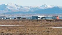TOGIAK, Alaska -- An Alaska Air National Guard C-130 transport plane sits on the runway here Nov. 15, 2016. The brought Santa, Mrs. Claus and about 50 volunteer elves here as part of Operation Santa Claus, an Alaska National Guard-led program that delivers toys, school supplies and other gifts to children in Alaska's remote villages. National Guard photo by Maj. John Callahan.