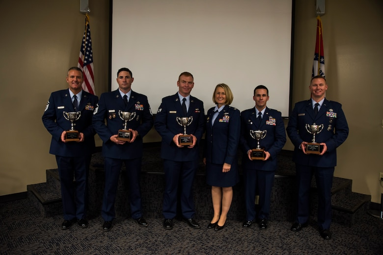 The Outstanding Airman of the Year winners present their trophies beside Col. Bobbi Doorenbos, 188th Wing commander, Nov. 5, 2016, at Ebbing Air National Guard Base, Fort Smith, Ark. The Outstanding Airman of the Year program promotes professional development, innovation and mission success by recognizing those who excel in their carrier fields while fostering the cultivation of ready, responsive and highly-skilled Airman. (U.S. Air National Guard photo by Senior Airman Cody Martin)