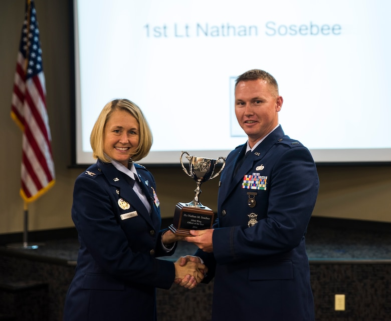 1st Lt. Nathan Sosebee, 188th Security Forces Squadron, is awarded the 2016 Company Grade Officer of the Year Nov. 5, 2016, at Ebbing Air National Guard Base, Fort Smith, Ark. The Outstanding Airman of the Year program promotes professional development, innovation and mission success by recognizing those who excel in their carrier fields while fostering the cultivation of ready, responsive and highly-skilled Airman. The award was presented to Sosebee by Col. Bobbi Doorenbos, 188th Wing commander. (U.S. Air National Guard photo by Senior Airman Cody Martin)