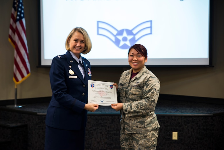Senior Airman Anna Siriboonheuang, 188th Operations Support Squadron, is awarded the Outstanding Airman of the Quarter award Nov. 5, 2016, for the final quarter of fiscal year 2016 at Ebbing Air National Guard Base, Fort Smith, Ark. The Outstanding Airman of the Quarter program promotes professional development, innovation and mission success by recognizing those who excel in their carrier fields while fostering the cultivation of ready, responsive and highly-skilled Airman. The award was presented to Siriboonheuang by Col. Bobbi Doorenbos, 188th Wing commander. (U.S. Air National Guard photo by Senior Airman Cody Martin)