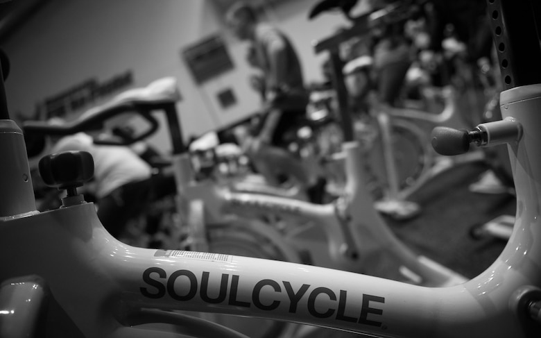 Participants of a United Service Organizations-hosted cycling class, SoulCycle, warm up prior to the start of the event at Ramstein Air Base, Germany, Nov. 15, 2016. Dozens of stationary bicycles were in compact rows within the small room. (U.S. Air Force photo by Airman 1st Class Lane T. Plummer)