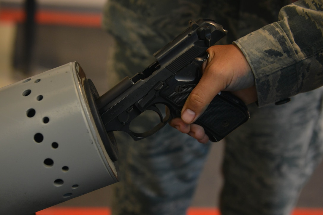 A U.S. Airman assigned to the 39th Security Forces Squadron clears an M9 pistol July 20, 2016, at Incirlik Air Base, Turkey. Security Forces Airmen are responsible for administering law enforcement and base defense. (U.S. Air Force photo by Senior Airman John Nieves Camacho)