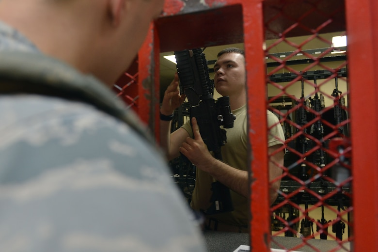 A U.S. Airman assigned to the 39th Security Forces Squadron prepares an M4 carbine for issue July 20, 2016, at Incirlik Air Base, Turkey. Security Forces Airmen report to the armory prior to duty for weapon and equipment issue. (U.S. Air Force photo by Senior Airman John Nieves Camacho)