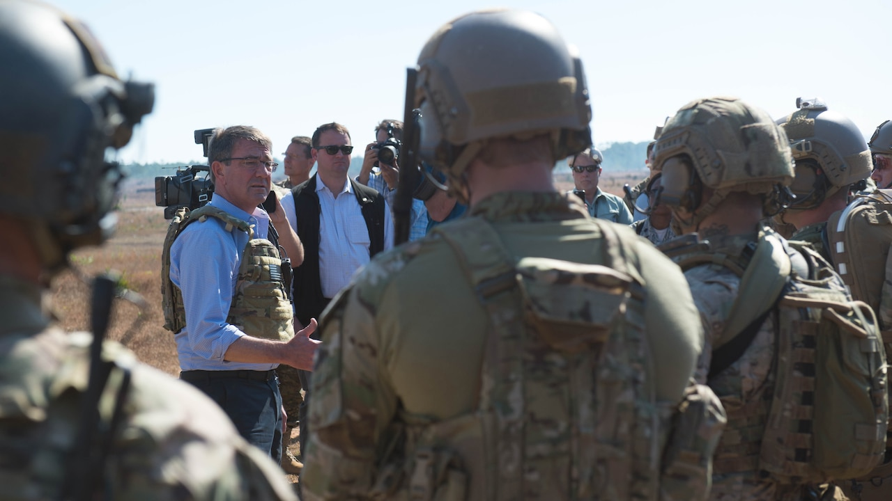 Defense Secretary Ash Carter speaks with the Air Force special operators during a visit to Eglin Air Force Base, Fla. It was the last stop on a three-state trip to meet with troops and assess readiness and effectiveness of training and equipment.