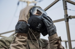 U.S. Marines and U.S. Airmen work together during a simulated contamination control area in preparation of Vigilant Ace 17-1 at Osan Air Base, Korea, Nov. 17, 2016. Vigilant Ace is a biannual, bilateral training event that exercises U.S. military and Republic of Korea Air Force interoperability through simulated wartime tasking.