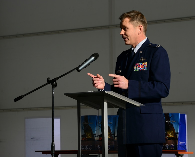 U.S. Air Force Col. Trevor Nitz, Heavy Airlift Wing commander, speaks during a C-17 Globemaster III hangar complex grand opening at Pàpa Air Base, Hungary on Nov. 17, 2016. The first-of-its-kind hangar complex provides space to wash and paint the three C-17s stationed at the HAW, and allows fuel cell, operational and routine maintenance to be performed at any time. (U.S. Air Force photo by Staff Sgt. Krystal Ardrey)