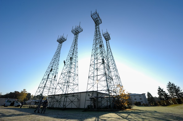 Airmen from the 86th Operations Support Squadron climb air traffic control radio antennas at Ramstein Air Base, Germany, Nov. 14, 2016. The Air Traffic Control and Landing Systems flight regularly checks all Instrument Landing System's parameters to ensure the antenna towers and monitors are performing correctly.(U.S. Air Force photo by Airman 1st Class Savannah L. Waters)