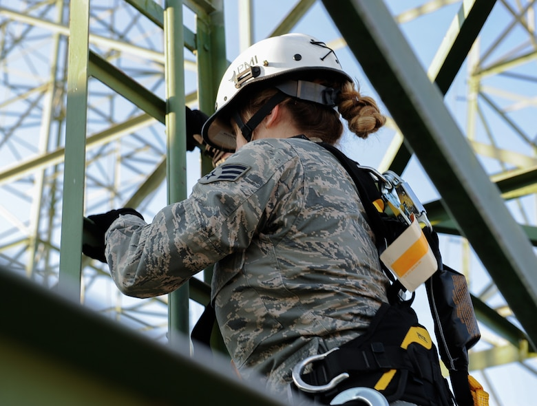Senior Airman Nikki Erling, 86th Operations Support Squadron airfield systems technician, climbs air traffic control radio antennas at Ramstein Air Base, Germany, Nov. 14, 2016. The 86th OSS performs visual inspection of the Navigational Aids and on the ground measurements to ensure the equipment is working. (U.S. Air Force photo by Airman 1st Class Savannah L. Waters)