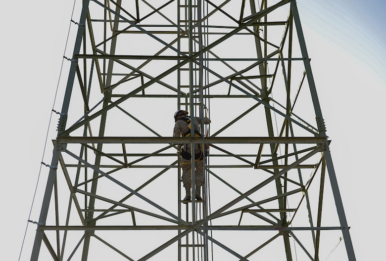 Senior Airman Nikki Erling, 86th Operations Support Squadron airfield systems technician, climbs air traffic control radio antennas at Ramstein Air Base, Germany, Nov. 14, 2016. The 86th Operations Support Squadron Air Traffic Control and Landing Systems flight maintains approximately 40dozens of air traffic control radio antennas across the base, furthering the mission to generate and employ airpower around the globe. (U.S. Air Force photo by Airman 1st Class Savannah L. Waters)