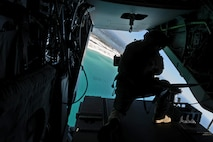 An aerial gunner with the 8th Special Operations Squadron mans the .50 caliber machine gun on a CV-22 Osprey Nov. 17, 2016 over Northwest Florida's gulf coast. Lt. Gen. Brad Webb, commander of Air Force Special Operations Command, escorted Secretary of Defense Ash Carter to the Eglin Range via CV-22 Osprey to observe a special tactics demonstration. (U.S. Air Force photo/Staff Sgt. Melanie Holochwost)