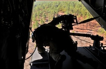 An aerial gunner with the 8th Special Operations Squadron prepares the CV-22 Osprey for landing on Eglin Range, Fla., Nov. 17, 2016. Secretary of Defense Ash Carter embedded with a special operations team to observe a simulated personnel recovery and strike mission featuring an AC-130U Gunship and CV-22 Ospreys. (U.S. Air Force photo/Staff Sgt. Melanie Holochwost)