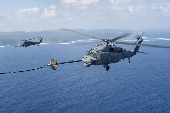 An MC-130H Combat Talon II from the 1st Special Operations Squadron refuels an HH-60 Pave Hawk from the 943rd Rescue Group during exercise Keen Sword 17 on Nov. 7, 2016, near Okinawa, Japan. U.S. forces will conduct training with their Japan Self-Defense Force counterparts at military installations throughout mainland Japan, Okinawa and in the waters surrounding Japan. (U.S. Air Force photo/Airman 1st Class Corey M. Pettis)