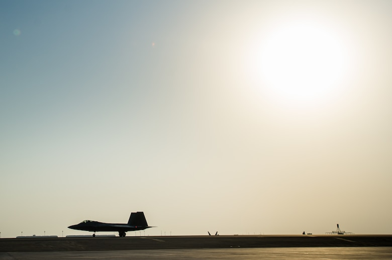 Brig. Gen. Charles Corcoran, the 380th Air Expeditionary Wing commander and F-22 Raptor pilot, taxis across a flightline after successfully completing 1,000 flight hours in the F-22 at an undisclosed location in Southwest Asia Nov. 11, 2016. F-22's have conducted more than 700 sorties in support Operation Inherent Resolve. (U.S. Air Force photo/Senior Airman Tyler Woodward)