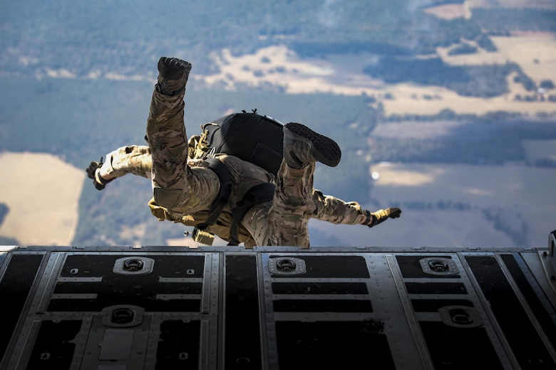 A pararescueman from the 38th Rescue Squadron jumps from an HC-130J Combat King II during a rapid-rescue exercise Nov. 2, 2016, in the skies over Marianna, Fla. The exercise was designed to test the 347th Rescue Group's ability to rapidly deploy, plan and execute rescue operations in combat environments. The exercise included HC-130J, HH-60G Pave Hawks, C-17 Globemaster IIIs, A-10C Thunderbolt IIs, E-8C Joint Stars, pararescuemen, maintenance, intelligence and support personnel. (U.S. Air Force photo/Staff Sgt. Ryan Callaghan)