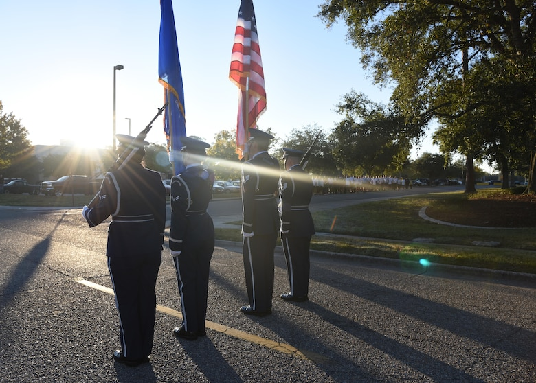 The Keesler Air Force Base Honor Guard posts the colors during the singing of the national anthem during an 81st Training Wing color run Nov. 17, 2016, on Keesler Air Force Base, Miss. The run was one of several events held throughout Dragon Week, which focuses on resiliency and teambuilding initiatives across the base. (U.S. Air Force photo by Kemberly Groue/Released)