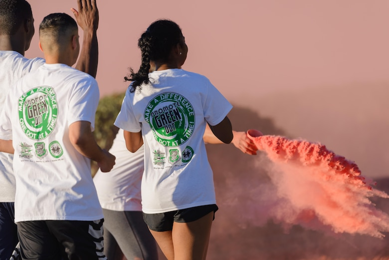 Keesler personnel participate in an 81st Training Wing color run at the Marina Park Nov. 17, 2016, on Keesler Air Force Base, Miss. The run was one of several events held throughout Dragon Week, which focuses on resiliency and teambuilding initiatives across the base. (U.S. Air Force photo by André Askew/Released)