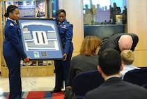 Cadets from Cadet Squadron 02 hold a frame containing a Women's Rugby Team jersey with the number worn by Maj. Adrianna Vorderbruggen, Nov. 12, 2016, at the U.S. Air Force Academy. Vorderbruggen, a 2002 Academy graduate and member of the national championship-winning rugby team, was a U.S. Air Force Office of Special Investigations agent who died last year in Afghanistan. Her family, friends and OSI coworkers dedicated a memorial in her honor, displayed in the hallway near CS02. (U.S. Air Force photo/Tech. Sgt. Mike Slater)