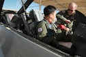 Evan Thomas (right), U.S. Air Force Test Pilot School instructor, gives a Republic of South Korea Air Force pilot some tips while sitting in an F-16 Nov. 3. (U.S. Air Force photo by Joseph Gocong)