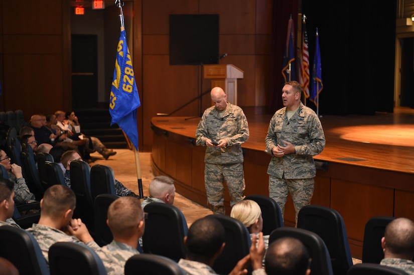 Col. Robert Lyman, 628th Air Base Wing commander, right, and Chief Master Sgt. Todd Cole, 628th Air Base Wing command chief, left, answer questions during a commander's call in the Air Base Theater Nov. 17, 2016. During the commander's call, Lyman recognized several individuals for recent accomplishments and spoke to how well the members of the base handled the Hurricane Matthew evacuation efforts.