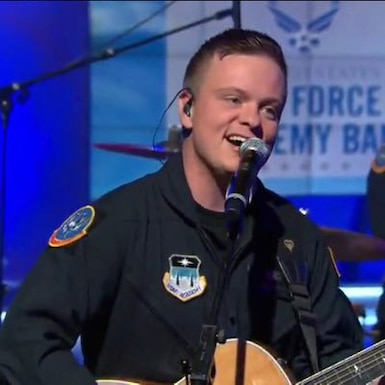"""Airman 1st Class Jamie Teachenor, a Nashville singer-songwriter, is featured on the """"Here We Are,"""" Wild Blue Country's latest release. Wild Blue Country is the U.S. Air Force Academy Band's Country Music ensemble. Before enlisting in the Air Force in 2015, Teachenor, 36, spent the better part of two decades singing on Country Music recordings and writing songs for mainstream Country artists Luke Bryan, Blake Shelton, Trisha Yearwood, and others. (U.S. Air Force photo)"""